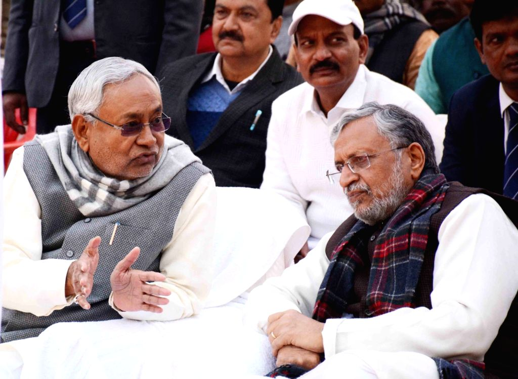 Bihar Chief Minister Nitish Kumar and Deputy Chief Minister Sushil Kumar Modi during the birth anniversary celebrations of Former Bihar Chief Minister Late Karpoori Thakur, in Patna on Jan 24, ... - Nitish Kumar and Sushil Kumar Modi