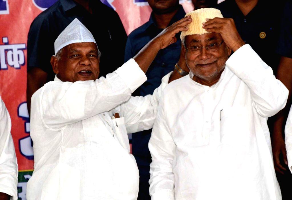 Bihar Chief Minister Nitish Kumar and HAM-S chief Jitan Ram Manjhi during an iftar party in Patna, on June 3, 2019. - Nitish Kumar