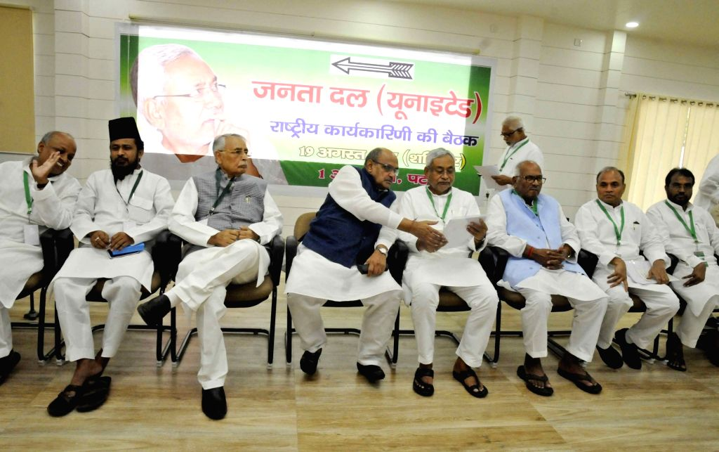 Bihar Chief Minister Nitish Kumar and JD(U) General Secretary and National Spokesperson K. C. Tyagi with other party leaders during the party's national executive meeting in Patna on Aug 19, ... - Nitish Kumar