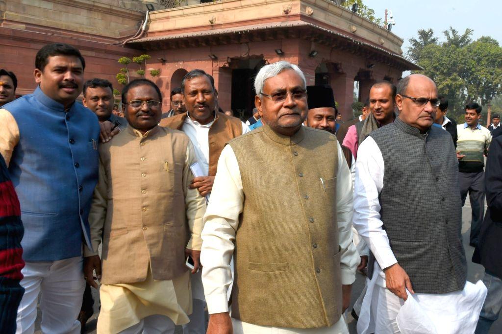 Bihar Chief Minister Nitish Kumar and JD(U) GS KC Tyagi at the Parliament in New Delhi, on Dec 10, 2015.