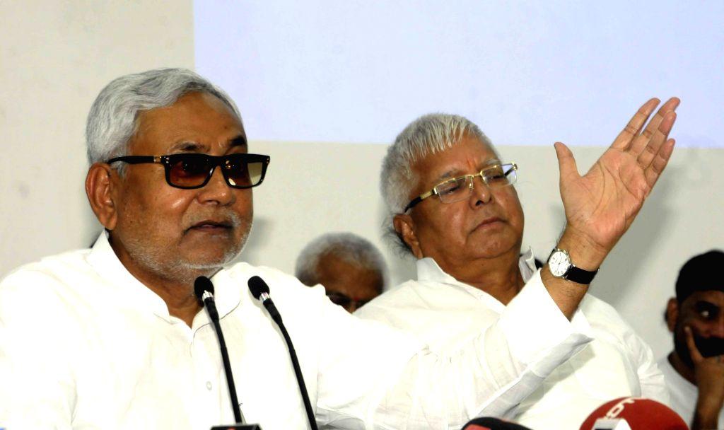 Bihar Chief Minister Nitish Kumar and RJD chief Lalu Prasad Yadav addresses a press conference in Patna on Aug 12, 2015. - Nitish Kumar and Lalu Prasad Yadav