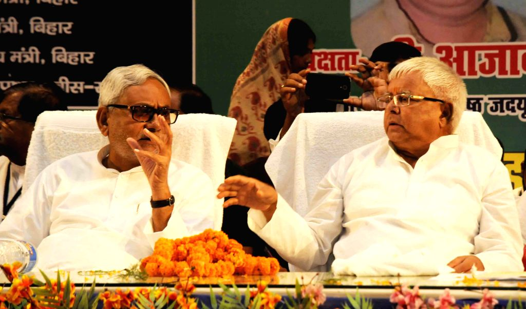 Bihar chief Minister Nitish Kumar and RJD chief Lalu Yadav during a programme in Patna on Aug 13, 2015.