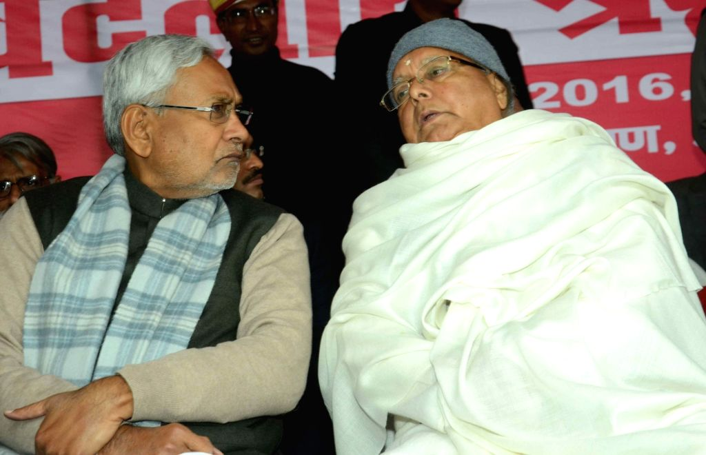 Bihar Chief Minister Nitish Kumar and RJD chief Lalu Prasad Yadav  during a programme organised to pay tribute to CPI leader A B Bardhan in Patna on Jan 20, 2016. - Nitish Kumar and Lalu Prasad Yadav
