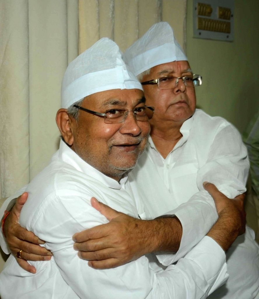 Bihar Chief Minister Nitish Kumar and RJD chief Lalu Prasad Yadav during an Iftar Party organised at his residence in Patna, on June 25, 2016. - Nitish Kumar and Lalu Prasad Yadav