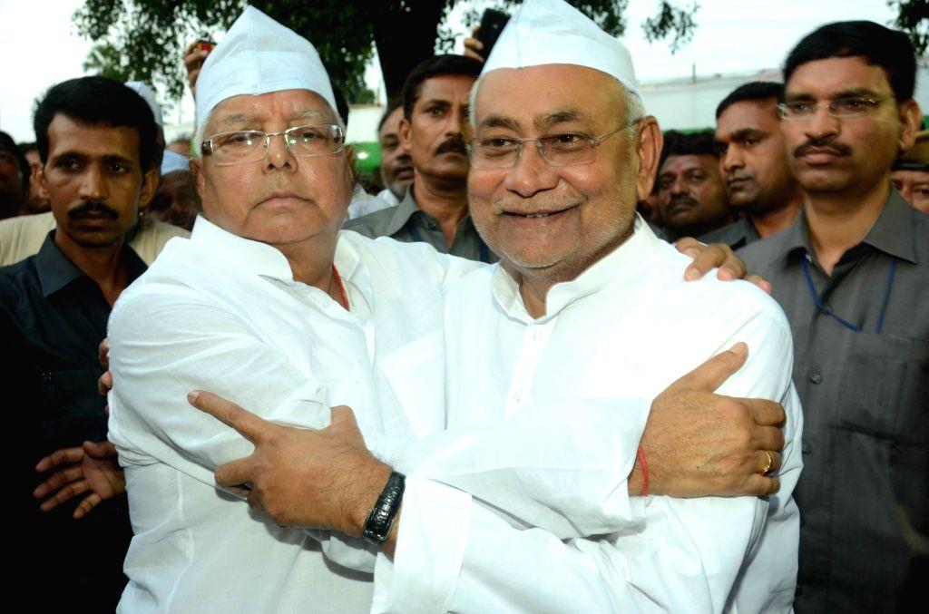 Bihar Chief Minister Nitish Kumar and RJD chief Lalu Prasad Yadav during an iftaar party thrown by Lalu in Patna, on July 1, 2016. - Nitish Kumar and Lalu Prasad Yadav