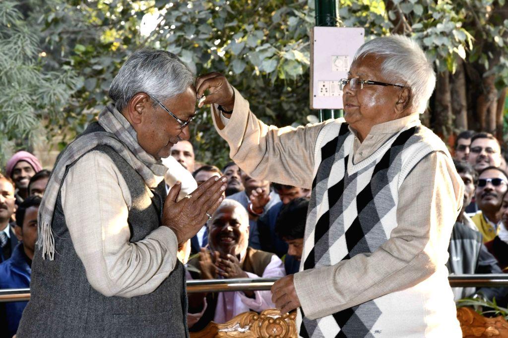 Bihar Chief Minister Nitish Kumar and RJD chief Lalu Prasad Yadav greet each other on Makar Sankrati in Patna on Jan 14, 2017. - Nitish Kumar and Lalu Prasad Yadav