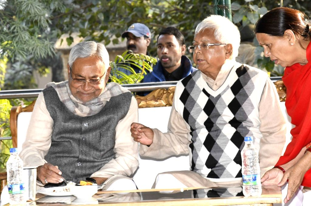 Bihar Chief Minister Nitish Kumar and RJD chief Lalu Prasad Yadav celebrate Makar Sankrati in Patna on Jan 14, 2017. - Nitish Kumar and Lalu Prasad Yadav