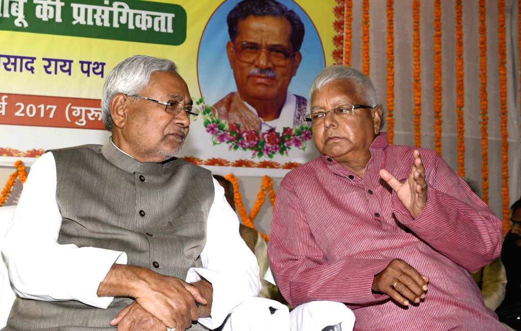 Bihar Chief Minister Nitish Kumar and RJD Chief Lalu Prasad Yadav during a programme organised to celebrate Ram Lakhan Singh birth anniversary in Patna on March 9, 2017. - Nitish Kumar, Lalu Prasad Yadav and Lakhan Singh