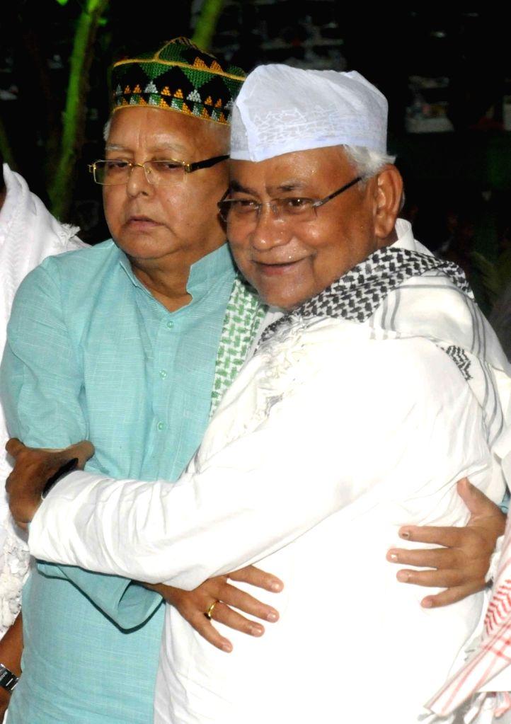 Bihar Chief Minister Nitish Kumar and RJD chief Lalu Yadav during an iftaar party organised at Yadav's residence in Patna on June 23, 2017. - Nitish Kumar and Lalu Yadav