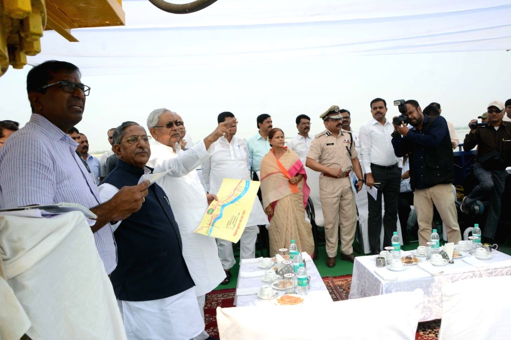 Bihar Chief Minister Nitish Kumar and the state's cabinet minister Nand Kishore Yadav during the inspection of Chhath Puja preparations at Ganga Ghat in Patna on Nov 3, 2018. - Nitish Kumar and Nand Kishore Yadav
