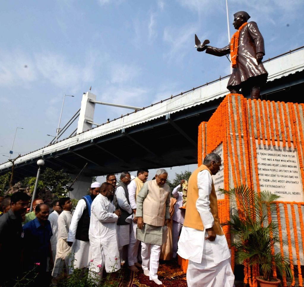 Bihar Chief Minister Nitish Kumar arrives to pay tributes to the country's first Prime Minister Pandit Jawaharlal Nehru on his 130th birth anniversary in Patna on Nov 14, 2019. Also seen Bihar ... - Nitish Kumar and Phagu Chauhan