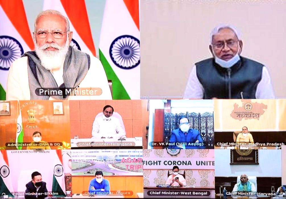 Bihar Chief Minister Nitish Kumar attends the meeting chaired by Prime Minister Narendra Modi to take stock of the COVID-19 situation in the states, with the Chief Ministers via video ... - Nitish Kumar and Narendra Modi