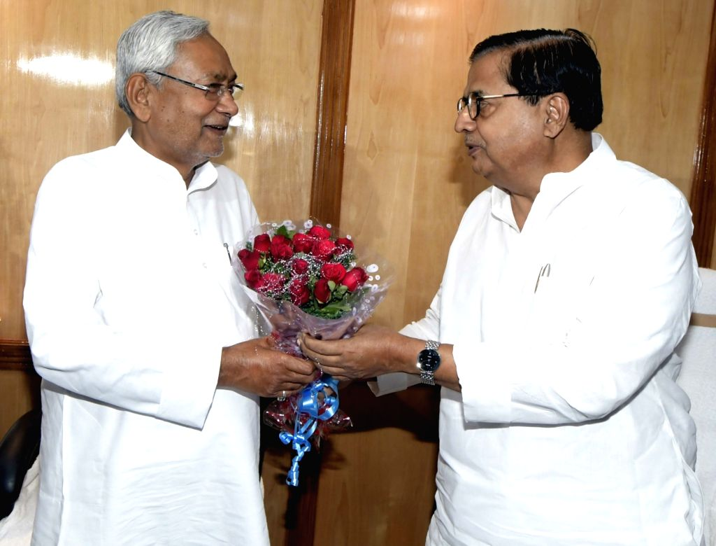 Bihar Chief Minister Nitish Kumar being greeted by Bihar Legislative Council Chairman Mohammad Haroon Rashid at the oath taking ceremony of newly elected BJP MLC Radha Mohan Sharma and JD-U ... - Nitish Kumar and Radha Mohan Sharma