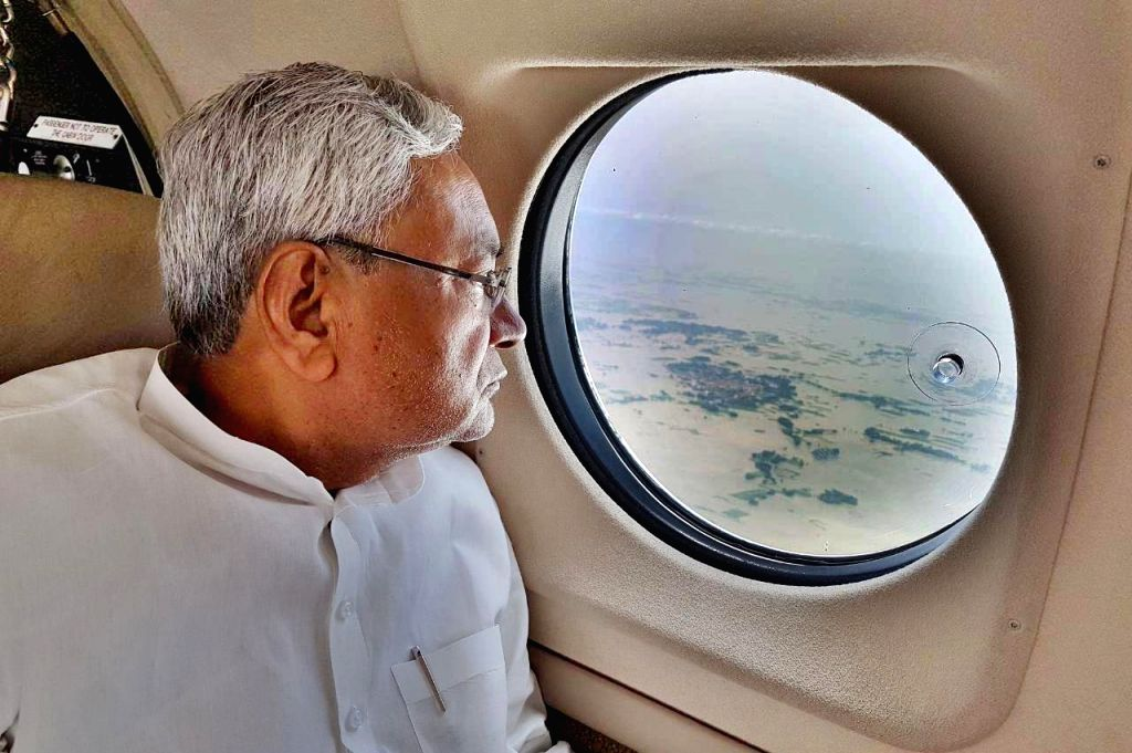 Bihar Chief Minister Nitish Kumar conducts an aerial survey of flood affected areas in Purnia district of Bihar on Aug 14, 2017. - Nitish Kumar