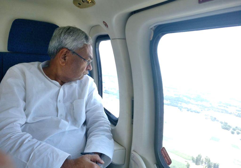 Bihar Chief Minister Nitish Kumar conducts an aerial survey of flood affected areas in Bettiahdistrict of Bihar on Aug 17, 2017. - Nitish Kumar