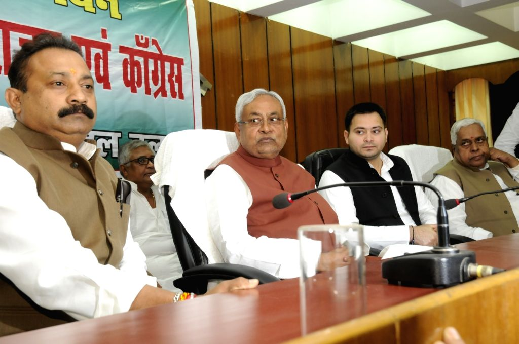 Bihar Chief Minister Nitish Kumar, Deputy Chief Minister Tejashwi Yadav, Education Minister Ashok Choudhry and Sadanand Singh during a meeting of the members of the grand alliance in ... - Nitish Kumar, Tejashwi Yadav and Sadanand Singh