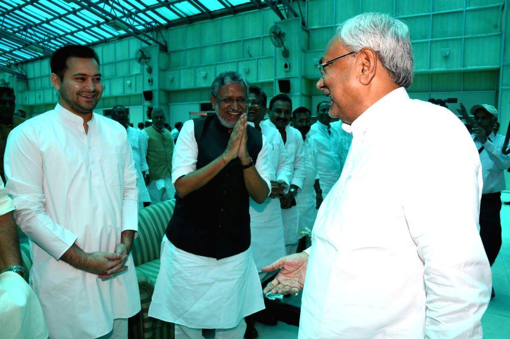 Bihar Chief Minister Nitish Kumar, Deputy Chief Minister Tejashwi Yadav and BJP leader Sushil Kumar Modi during at the Bihar Governor's swearing-in ceremony at Raj Bhawan in Patna on June 22, ... - Nitish Kumar, Tejashwi Yadav and Sushil Kumar Modi