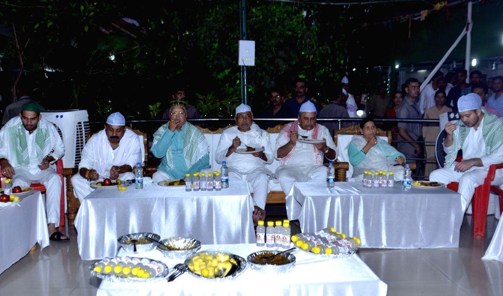 Bihar Chief Minister Nitish Kumar, Deputy Chief Minister Tejashwi Yadav and RJD chief Lalu Yadav during an iftaar party organised at Yadav's residence in Patna on June 23, 2017. Also seen ... - Nitish Kumar, Tejashwi Yadav and Lalu Yadav