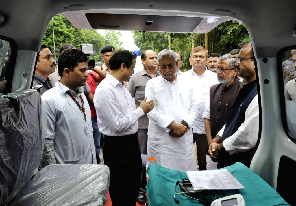 Bihar Chief Minister Nitish Kumar, Deputy Chief Minister Sushil Kumar Modi and Health Minister Mangal Pandey during the launch of ambulance services in Patna on Aug 12, 2017. - Nitish Kumar, Sushil Kumar Modi and Mangal Pandey