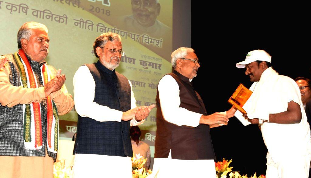 Bihar Chief Minister Nitish Kumar, Deputy Chief Minister Sushil Kumar Modi and Cabinet Minister Prem Kumar during a programme in Patna on Feb 13, 2018. - Nitish Kumar, Sushil Kumar Modi and Prem Kumar