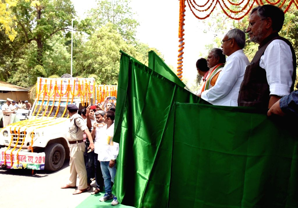 Bihar Chief Minister Nitish Kumar, Deputy Chief Minister Sushil Kumar Modi and state Agriculture Minister Prem Kumar flag off seed development vehicles under the 'Kharif Maha Abhiyan' in Patna ... - Nitish Kumar, Sushil Kumar Modi and Prem Kumar