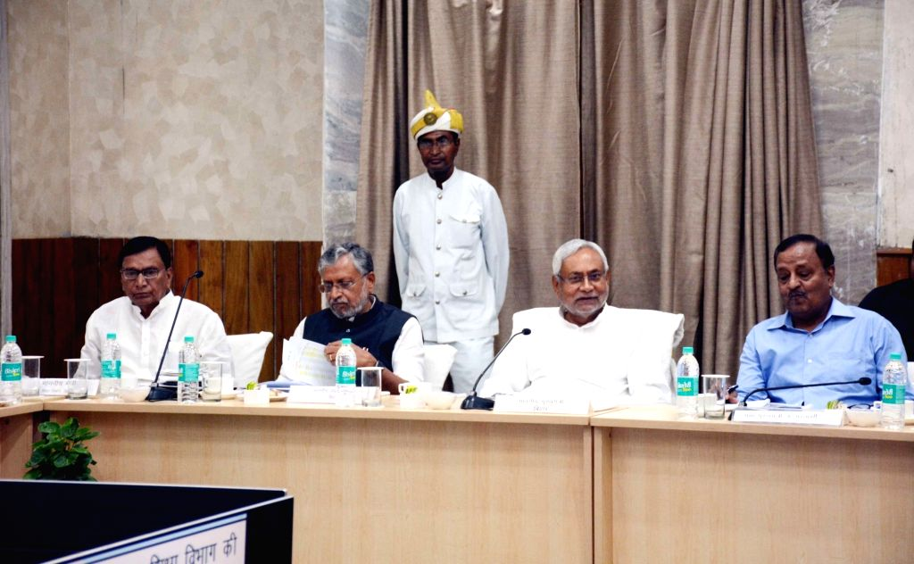 Bihar Chief Minister Nitish Kumar, Deputy Chief Minister Sushil Kumar Modi and state Education Minister Krishna Nandan Prasad Verma during a review meeting of the Education Department, in ... - Nitish Kumar, Sushil Kumar Modi and Nandan Prasad Verma