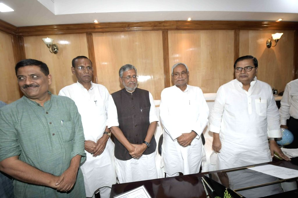 Bihar Chief Minister Nitish Kumar, Deputy Chief Minister Sushil Kumar Modi and state Legislative Council Chairman Mohammad Haroon Rashid with the newly elected BJP MLC Radha Mohan Sharma and ... - Nitish Kumar, Sushil Kumar Modi and Radha Mohan Sharma