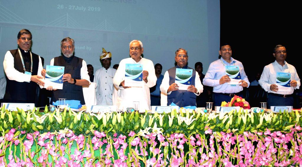 Bihar Chief Minister Nitish Kumar, Deputy Chief Minister Sushil Kumar Modi and Cabinet Minister Nand Kishore Yadav unveil a publication during a seminar on 'Major Bridges in Bihar', in Patna ... - Nitish Kumar, Sushil Kumar Modi and Nand Kishore Yadav