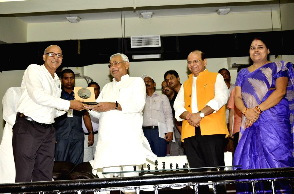Bihar Chief Minister Nitish Kumar distributes award and certificate to chess player during a prize distribution programme in Patna on Sept 11, 2017. - Nitish Kumar