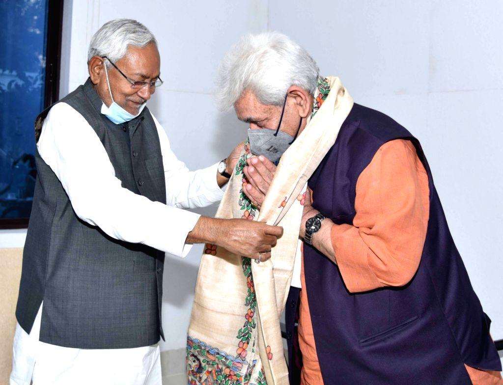 Bihar Chief Minister Nitish Kumar felicitate to Jammu and kashmir Lieutenant governor Manoj sinha during his visit in Patna on Saturday 06th March, 2021. - Nitish Kumar