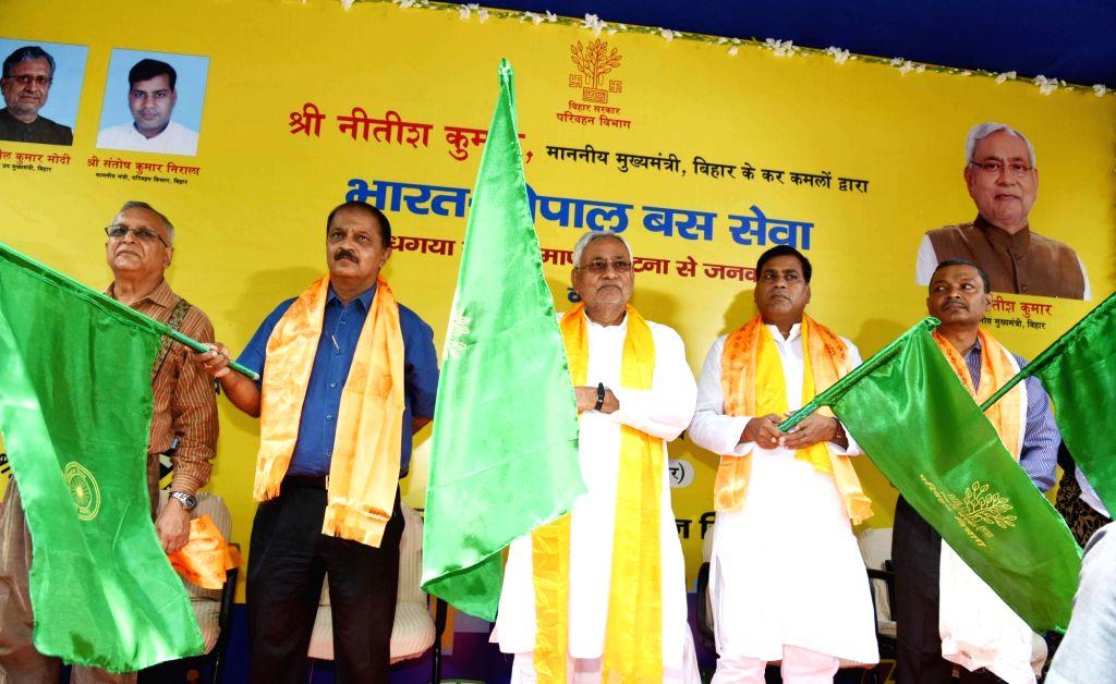 Bihar Chief Minister Nitish Kumar flags off the Indo-Nepal Bus Service from Bodh Gaya to Kathmandu and Patna to Janakpur; in Patna on Sept 11, 2018. - Nitish Kumar