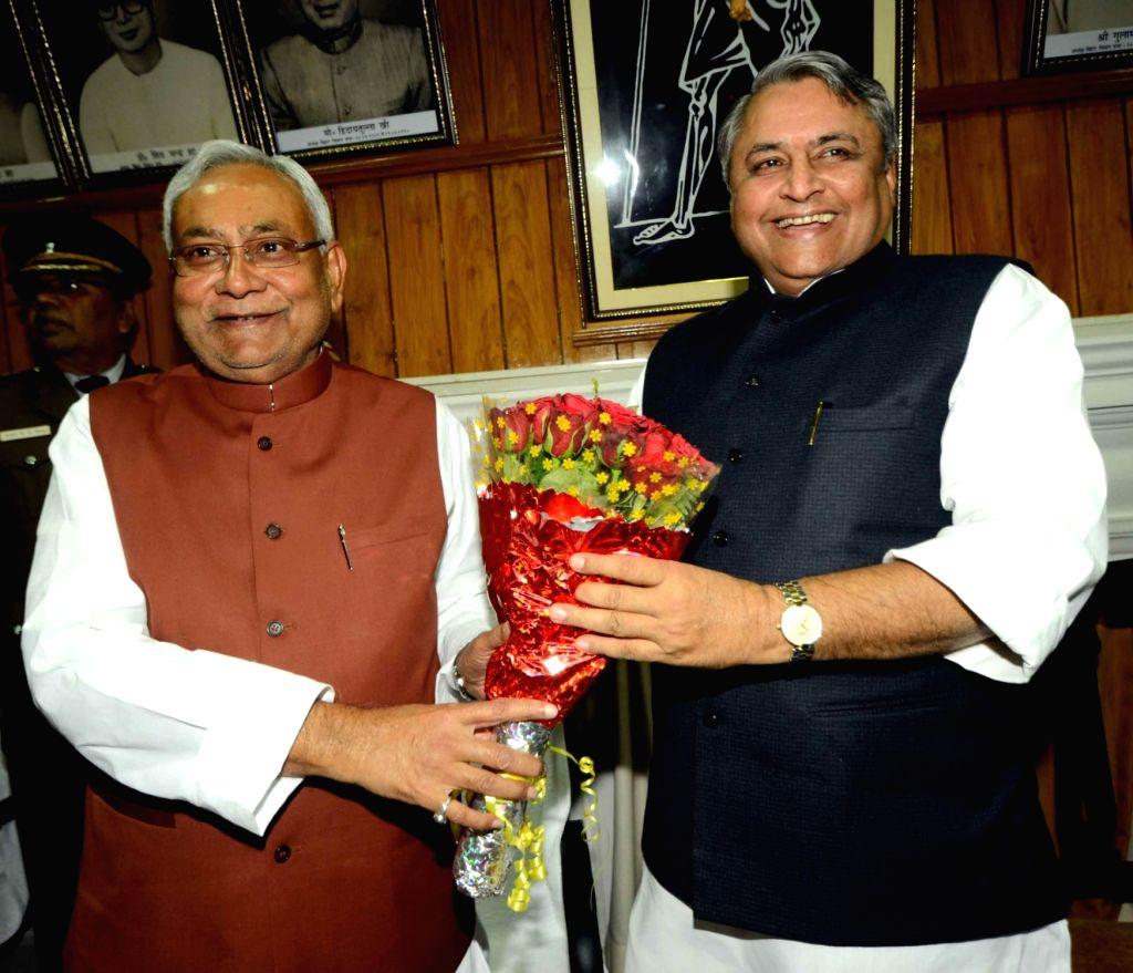 Bihar Chief Minister Nitish Kumar greets Bihar's Legislative Assembly Speaker Vijay Choudhry in Patna on Nov 25, 2016. - Nitish Kumar
