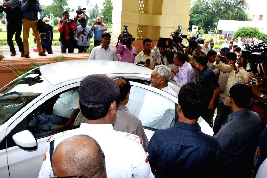 Bihar Chief Minister Nitish Kumar heads to attend the state assembly's monsoon session from his residence in an electric car which is considered an environment friendly and cost-effective mode ... - Nitish Kumar