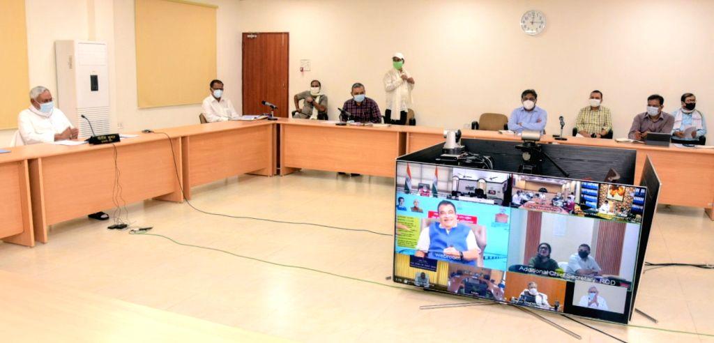 Bihar Chief Minister Nitish Kumar inaugurates the rehabilitated western flank of the Mahatma Gandhi Setu over the Ganga river between Patna and Hajipur, via video conferencing from Patna, on ... - Nitish Kumar and Gandhi Setu