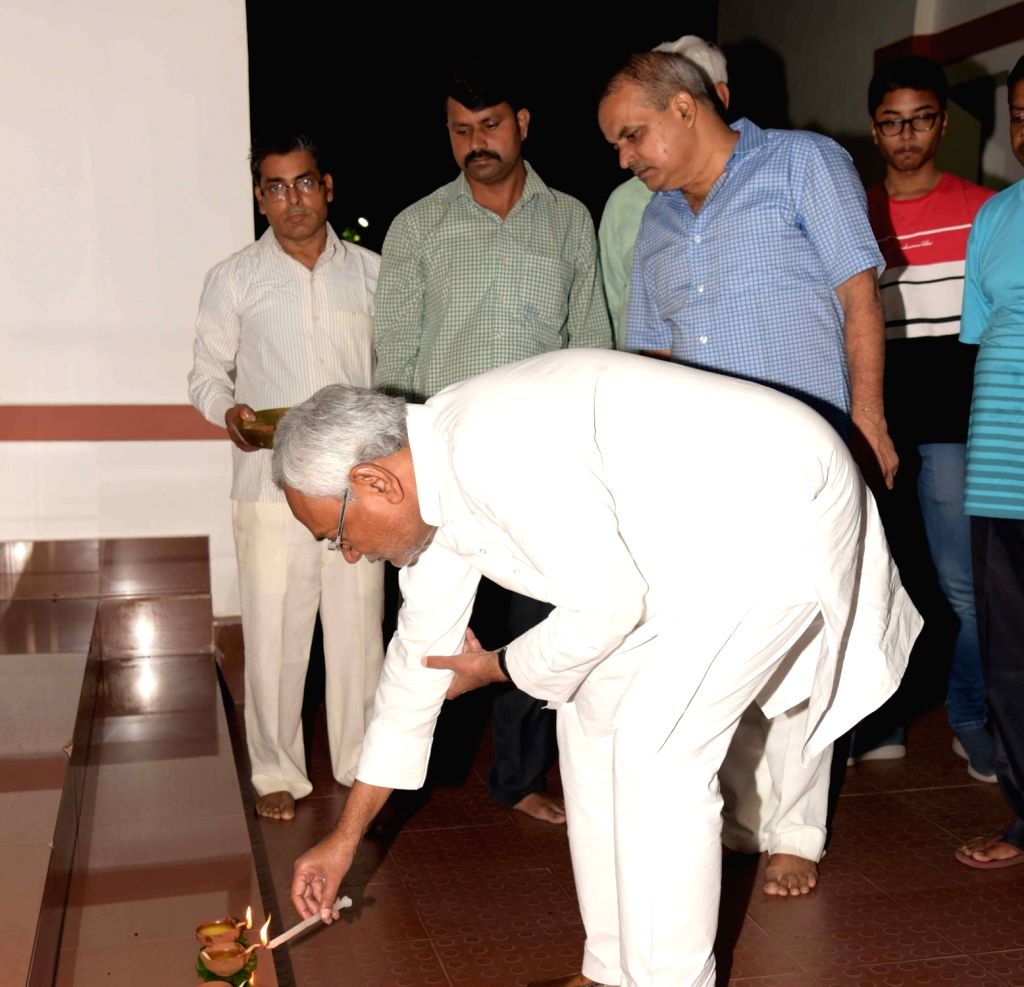 Bihar Chief Minister Nitish Kumar lighting a lamp at his residence on the occasion Deepawali in Patna on Oct 27, 2019. - Nitish Kumar