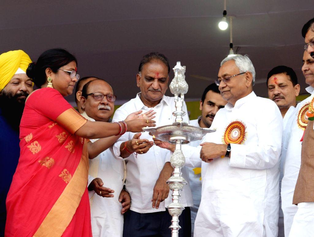 Bihar Chief Minister Nitish Kumar lights the lamp to inaugurate 'Ramleela Mahotsav' during Dussehra celebrations in Patna, on Oct 8, 2019. - Nitish Kumar
