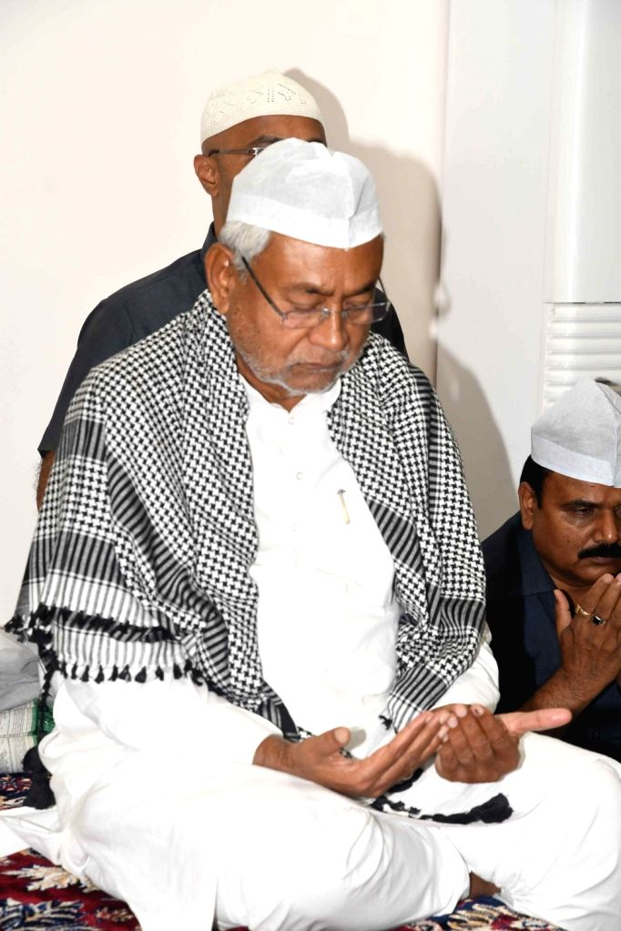 Bihar Chief Minister Nitish Kumar offer prayers during an iftar party at his official residence in Patna on May 28, 2019. - Nitish Kumar