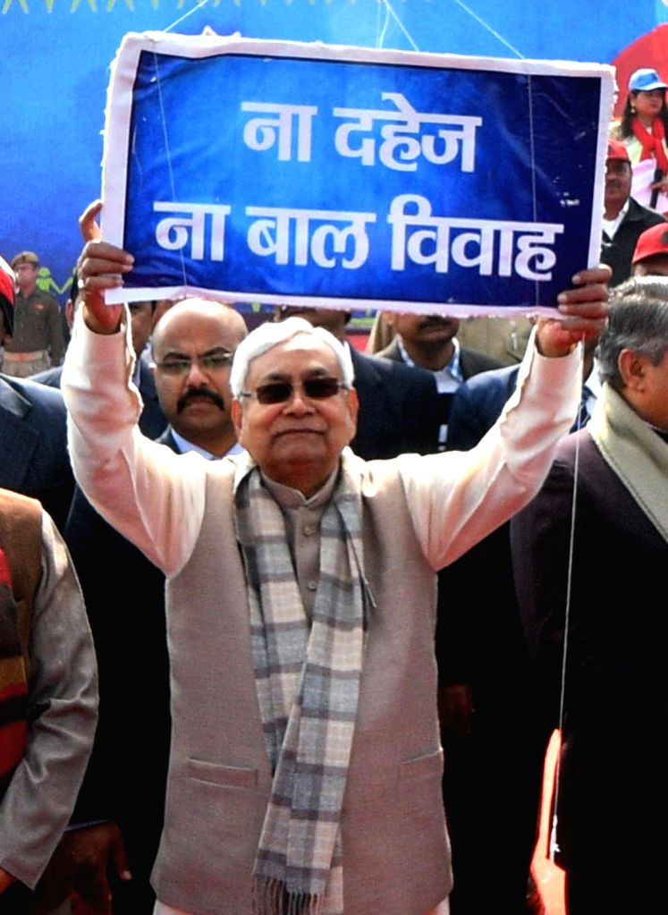 Bihar Chief Minister Nitish Kumar participates in a human chain formation to protest against dowry and child marriage in Patna on Jan 21, 2018. - Nitish Kumar