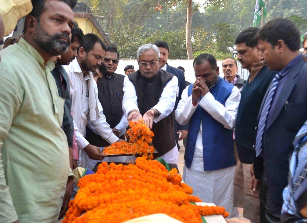 Bihar Chief Minister Nitish Kumar pay his last respect to Rashtriya Lok Samata Party (RLSP) MLA Basant Kumar Kushwaha who died of heart attack in Patna on Nov 30, 2015. - Nitish Kumar and Basant Kumar Kushwaha