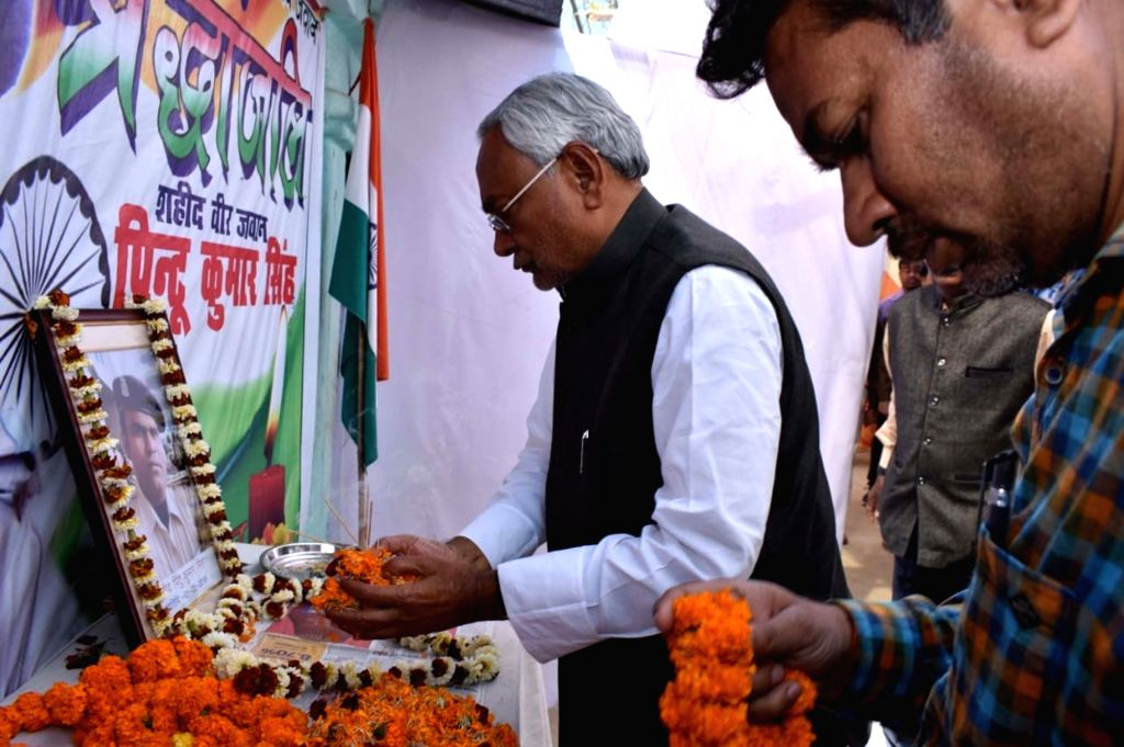Bihar Chief Minister Nitish Kumar pay tributes martyr Pintu Kumar Singh, in Begusarai district of the state on March 7, 2019. - Nitish Kumar and Pintu Kumar Singh