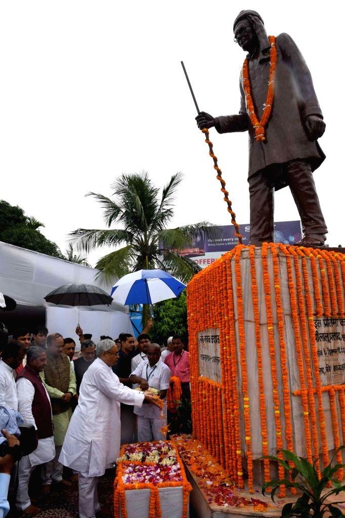 Bihar Chief Minister Nitish Kumar pays tribute to Jayaprakash Narayan on his birth anniversary in Patna on Oct 11, 2017. - Nitish Kumar