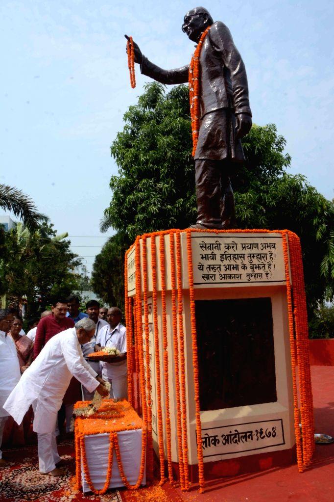 "Bihar Chief Minister Nitish Kumar pays tribute to Jayaprakash Narayan on ""Sampoorna Kranti Diwas"" in Patna, on June 5, 2018. - Nitish Kumar"
