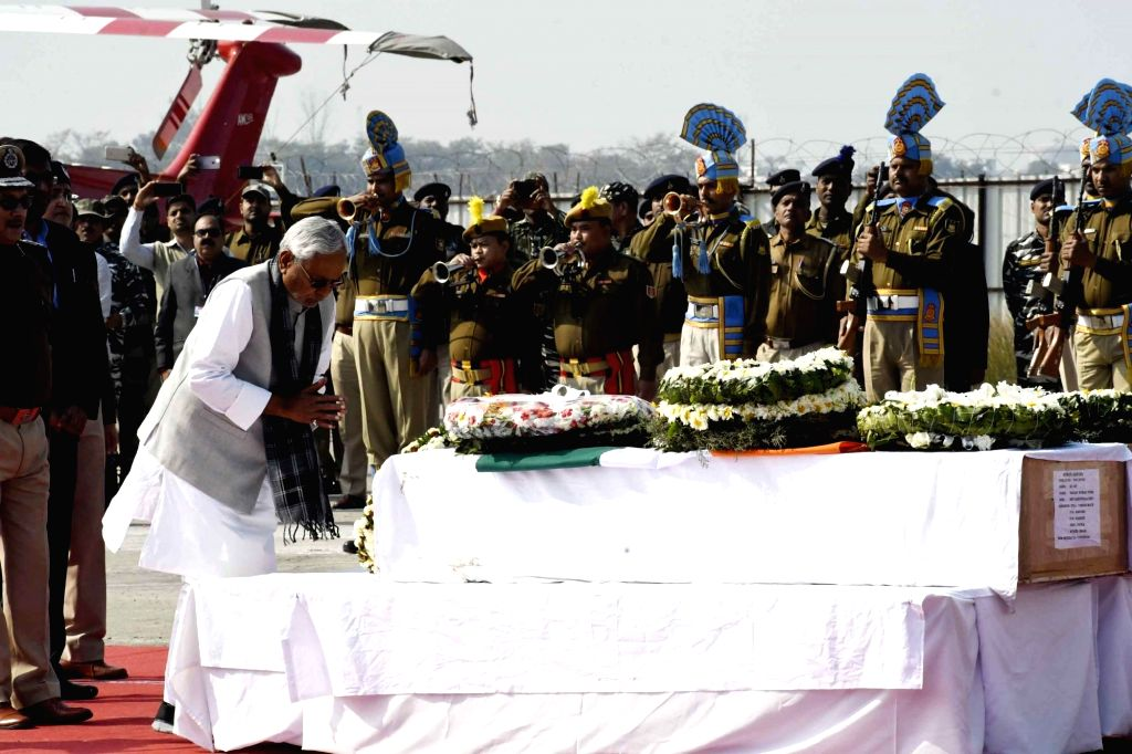 Bihar Chief Minister Nitish Kumar pays tribute to martyrs Ratan Kumar Thakur and Sanjay Kumar Sinha, who were among the 49 CRPF personnel killed in 14 Feb Pulwama militant attack, in Patna on ... - Nitish Kumar, Kumar Thakur and Sanjay Kumar Sinha