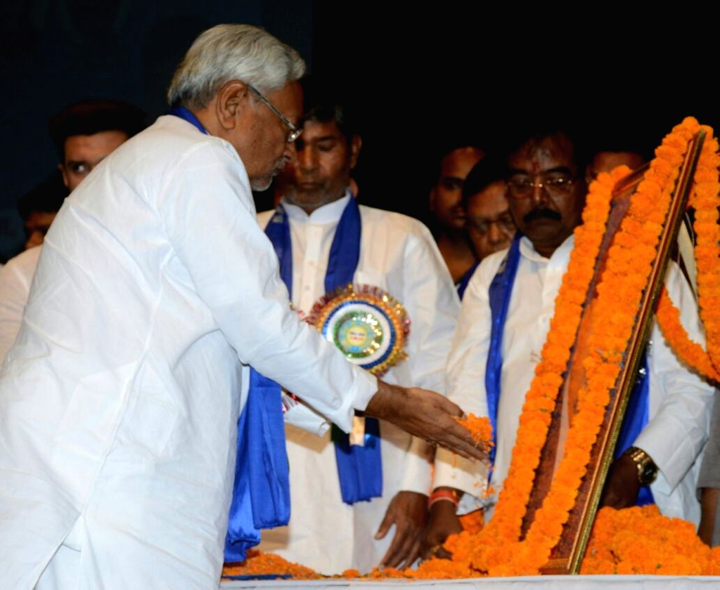 Bihar Chief Minister Nitish Kumar pays tributes to Dr. B.R. Ambedkar on his 127th birth anniversary during a programme organised by Lok Janshakti Party (LJP), in Patna on April 14, 2018. - Nitish Kumar