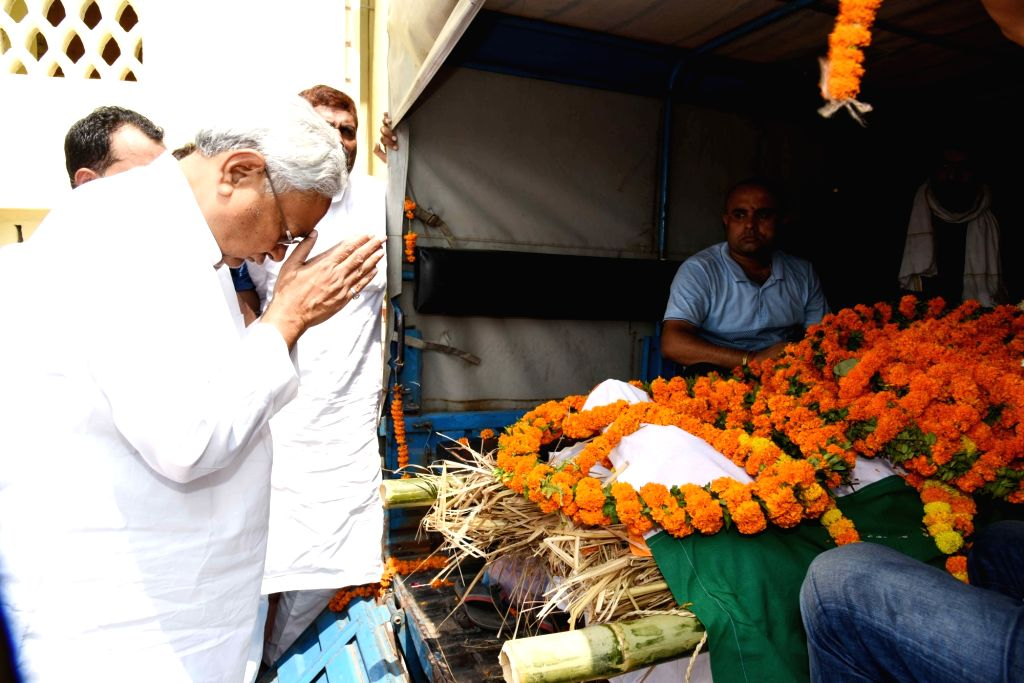 Bihar Chief Minister Nitish Kumar pays tributes to the mortal remains of senior Congress leader and former Union Minister L.P. Shahi, in Patna on June 10, 2018. Shahi died early on June 9, ... - Nitish Kumar