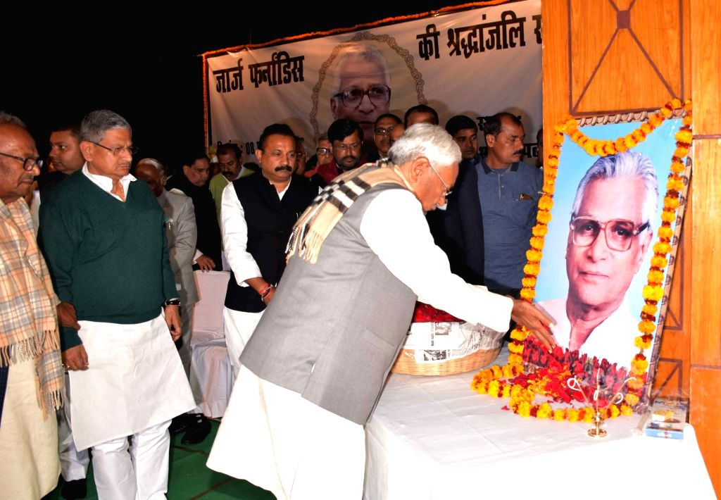 Bihar Chief Minister Nitish Kumar pays tributes to Former Defence Minister George Fernandes during a prayer meeting, in Patna on Feb 8, 2019. - Nitish Kumar and Fernandes
