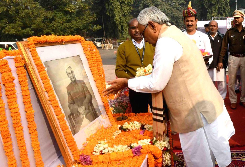 Bihar Chief Minister Nitish Kumar pays tributes to India's first President Rajendra Prasad on his 135th birth anniversary, in Patna on Dec 3, 2019. - Nitish Kumar