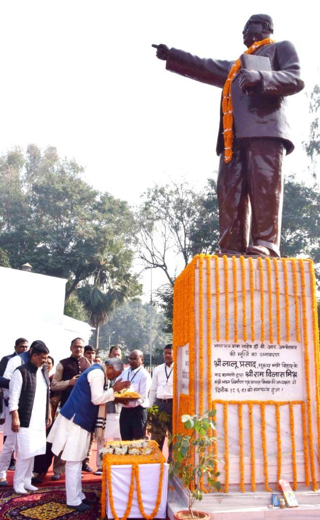 Bihar Chief Minister Nitish Kumar pays tributes to Dr B.R. Ambedkar on his 64th death anniversary commemorated as Mahaparinirvan Diwas, in Patna on Dec 6, 2019. - Nitish Kumar