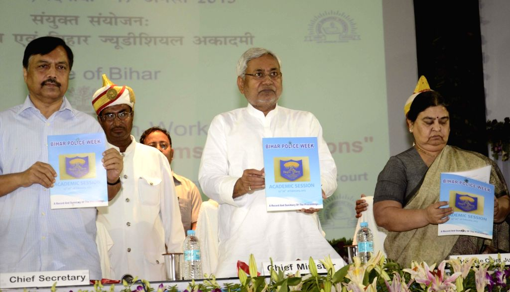 Bihar Chief Minister Nitish Kumar releasing a book ``Bihar Police Eeek`` during a workshop on criminal justice system in Patna on August 17, 2013. (Photo::: IANS)