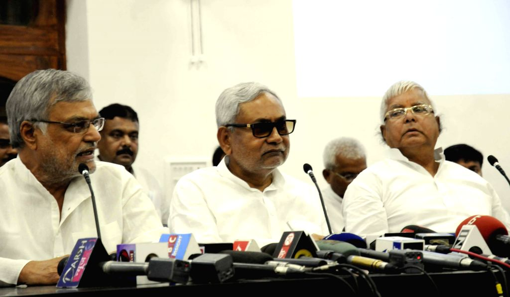 Bihar Chief Minister Nitish Kumar, RJD chief Lalu Prasad Yadav, Congress leader C. P. Joshi and others during a press conference in Patna on Aug 12, 2015. - Nitish Kumar, Lalu Prasad Yadav and C. P. Joshi